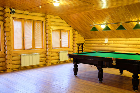snooker rooms: large green pool table Editorial