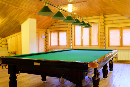 snooker hall: large green pool table Editorial