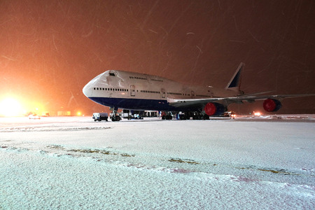 Moscow, Russia, February, 09,2015: commercial airplane parking at the airport in winter Editorial