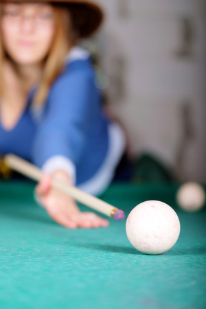 snooker halls: women are concentrated on a billiard ball number eight Stock Photo