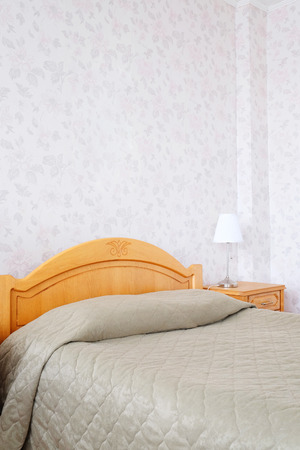 bed in motel room photo