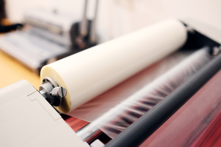 format: The image of a laminating machine