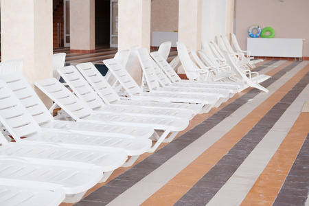 daybed: Many white empty chaise-longue Stock Photo