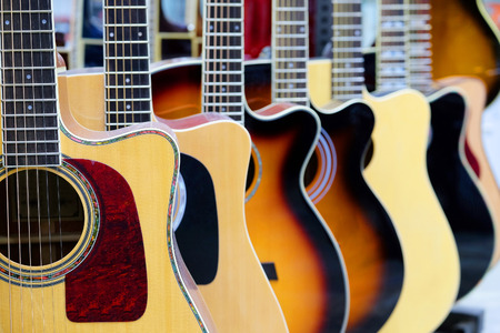 Guitars in the store background 스톡 콘텐츠