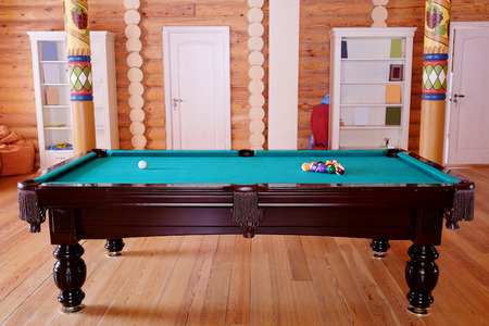 billiards rooms: Green billiard table