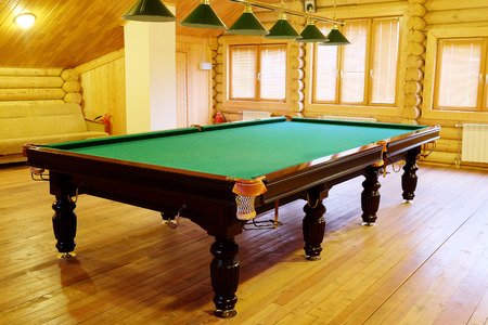 snooker halls: large green pool table Editorial