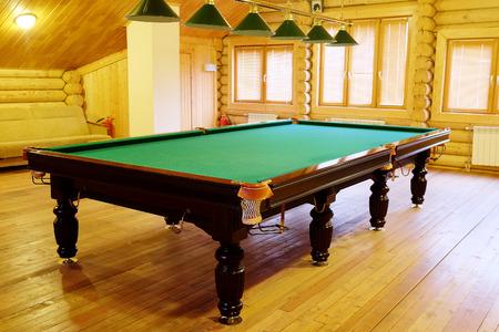 pool halls: large green pool table Editorial