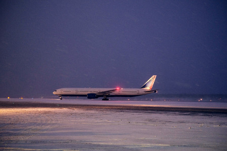 undercarriage: Moscow, Russia, February, 09,2015: commercial airplane parking at the airport in winter Editorial