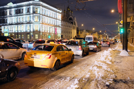 traffic jams: Moscow, Russia, December, 26, 2014: the plentiful snow, which dropped out the day before, led to emergence of multikilometer traffic jams on roads Editorial