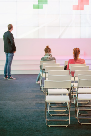 acting: audience listens to the acting in a conference hall Stock Photo