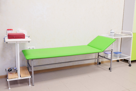 health care facilities: Patient examination table in a doctors office Stock Photo