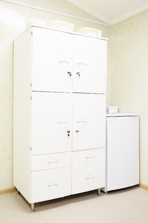 clench: White cupboard of a medical center Stock Photo