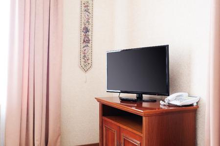 nightstands: Close up of plasma TV in hotel room Stock Photo