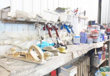 flatnose: Workplace of car painter. Old spray guns.