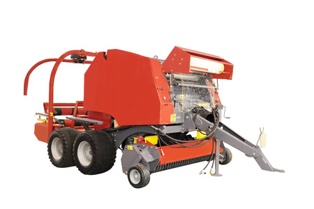 baler: Agricultural round baler  isolated under the white background Stock Photo
