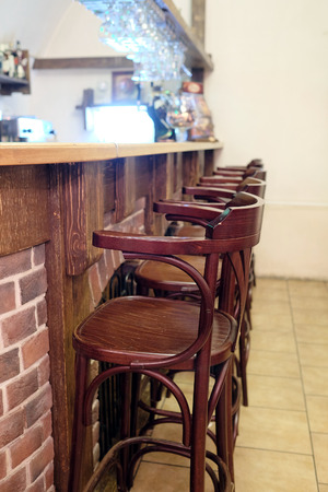 stools: Bar stools in a row by the counter