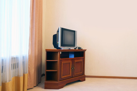 nightstands: TV in hotel room Stock Photo