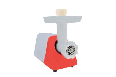 Electric meat grinder isolated on a white photo