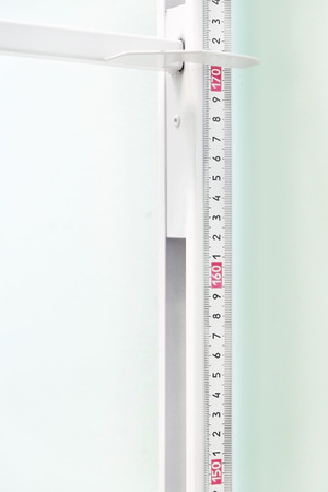 human height: Closeup stadiometer - human height measuring devices
