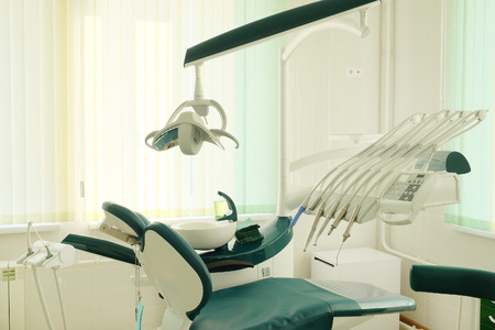 exam room: Dental tools on a dentists chair
