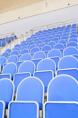 sports shell: Blue stadium seats hall handball Stock Photo