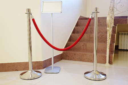 stanchion: Red rope barriers Stock Photo