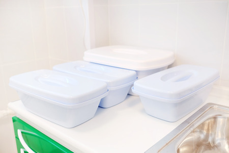 plastic to containers: Pale blue plastic containers Stock Photo