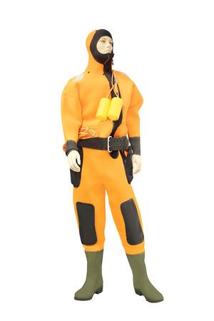 agachado: Maniquíes en un traje naranja de buceo