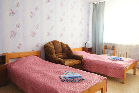 Two beds in motel room photo