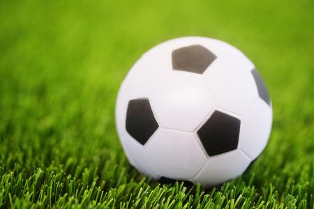 ballsport: Closeup soccer ball on soccer field