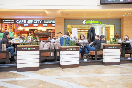 afimall: RUSSIA, MOSCOW - MARCH 19, 2015: Shopping center Afimall City people sit in cafes