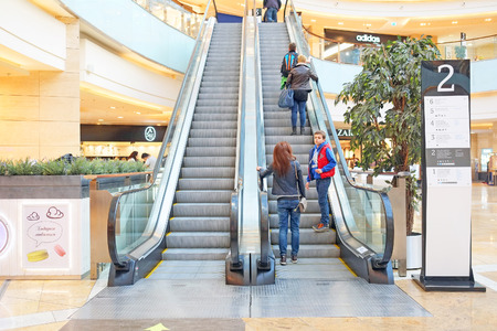 afimall: RUSSIA, MOSCOW - MARCH 19, 2015: escalator in Shopping center Afimall City Editorial