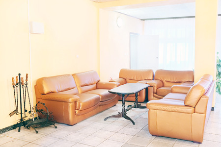 recreation room: Brown leather chairs and sofa. Recreation room Stock Photo