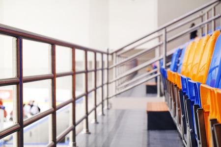 orange chairs: Ice Stadium - Empty blue and orange chairs Stock Photo