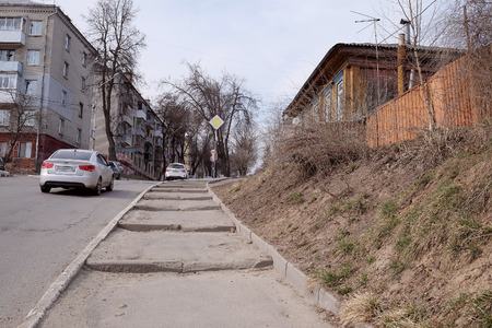 coexist: Bryansk, Russia, March, 28, 2015:  Street in the center of Bryansk; in this, located on a high hill, city urban neighborhoods coexist with private construction