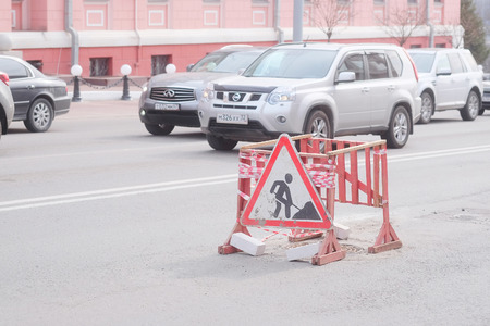 traffic jams: Bryansk, Russia, March, 28, 2015: traffic jams in Bryansk and fence of road repair Editorial