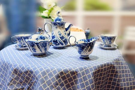 milkman: Set of milkman, teapot, cups, sugar bowl painted under Gzhel Stock Photo
