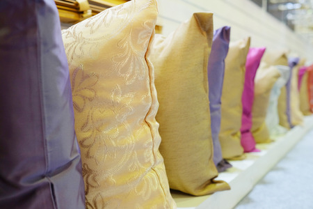 Rows of decorative pillows photo