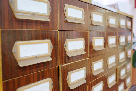 Old wooden drawers with catalog cards in library photo