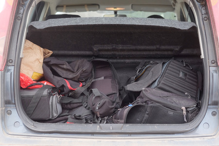 hatchback: Hatchback car loaded with open trunk and luggage