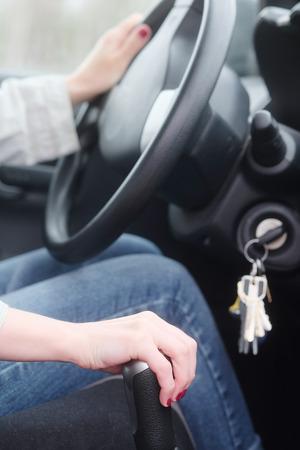 shifting: Woman manually shifting the car transmission