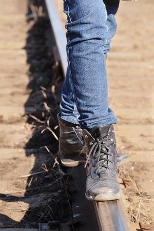 dangerously: Girl legs on the railway tracks