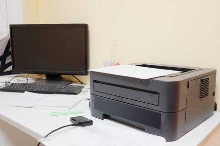 Black printer and paper closeup photo