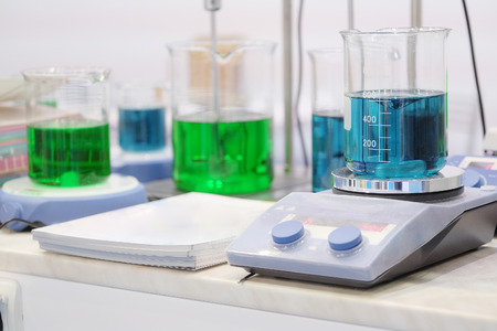 chemical substance: Laboratory equipment. Blue chemical substance in the beaker