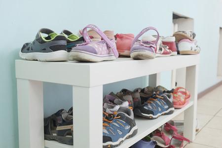 shoe shelf: White shoe shelf with children shoes Stock Photo