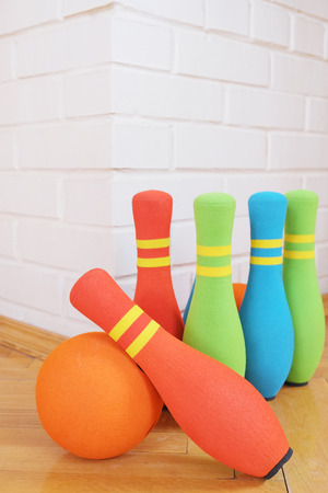 destroying the competition: Childrens toy. Bowling soft colorful pins Stock Photo