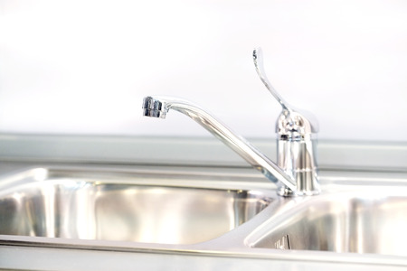 Stainless steel wash sinks with mixer tap 版權商用圖片