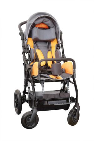 paraplegic: Silla de ruedas para ni�os aislados en el fondo blanco Foto de archivo