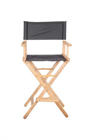 silla: Esqueleto en la ropa al lado de la silla de director de cine Foto de archivo
