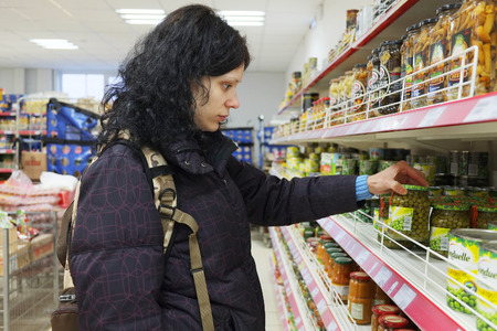 affordable: MOSCOW, RUSSIA  -  APRIL 07, 2015: Supermarket Pyaterochka with the most affordable prices. Russias largest retailer. Women shopping in supermarket